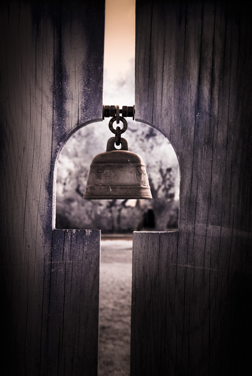 bell notched into Hui garden gate