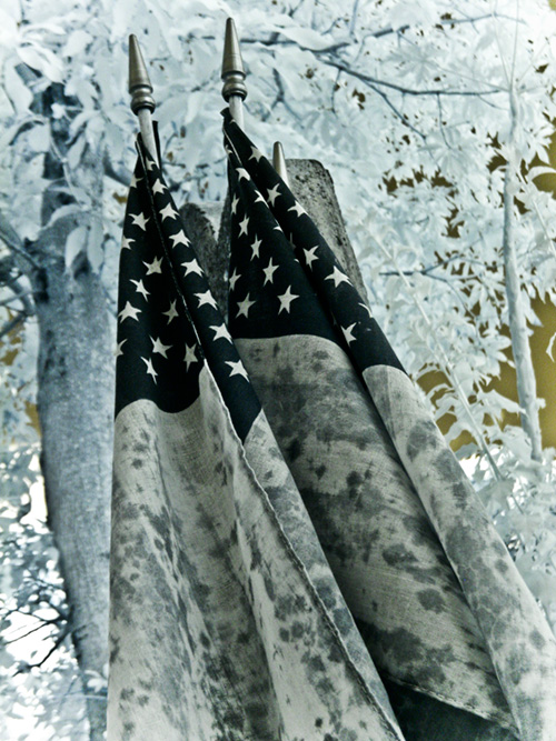 flags by a tombstone